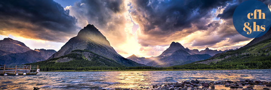 image of a sunset over Swiftcurrent Lake in Glacier National Park